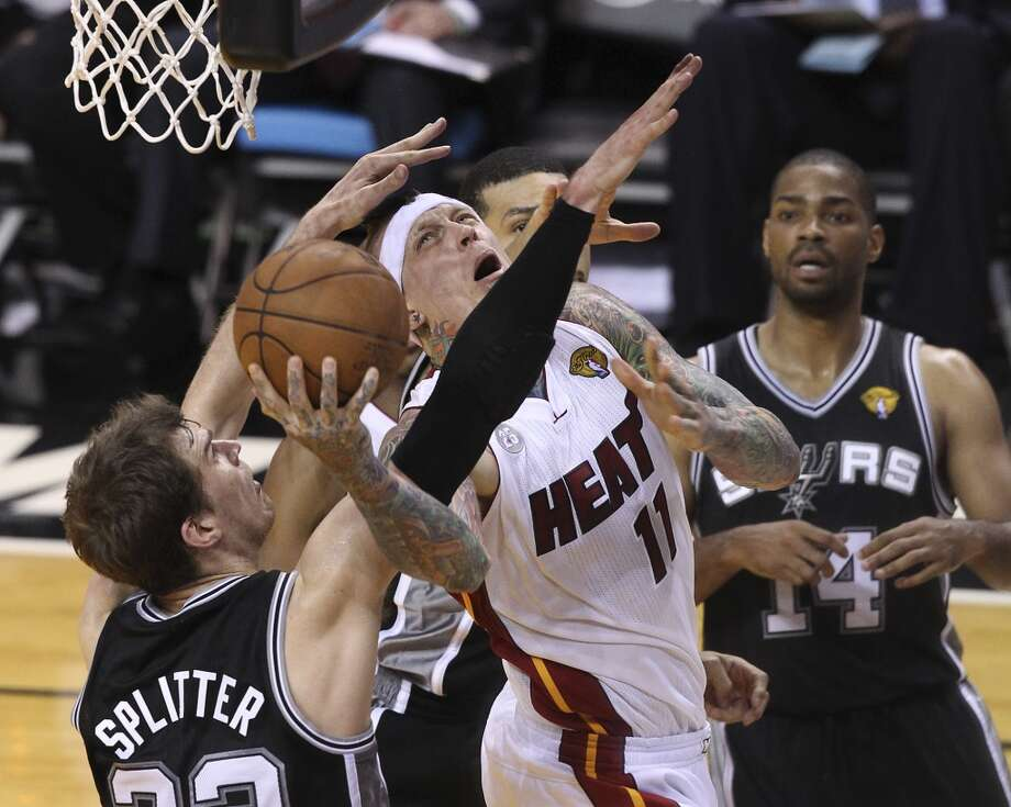 Miami Heat's Chris Andersen (11) takes a tough shot against Spurs' Tiago Splitter (22) in the second half of Game 2 of the NBA Finals at the American Airlines Arena in Miami on Sunday, June 9, 2013. The Heat take Game 2 over the Spurs, 103-84. (Kin Man Hui/San Antonio Express-News)