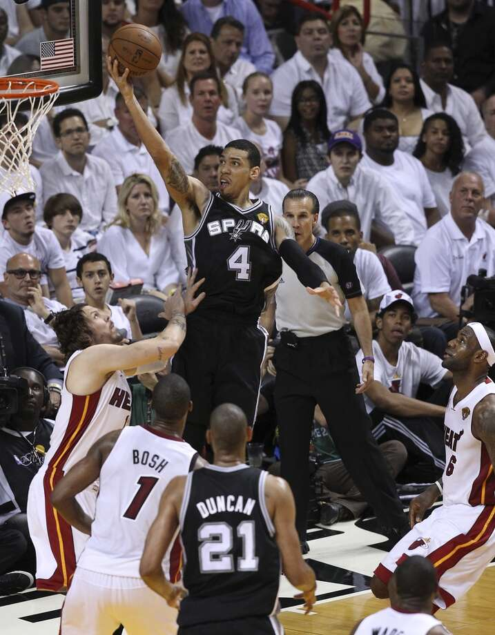 Spurs' Danny Green (04) drives for a shot against the Miami Heat's Mike Miller (13) during the second half of Game 2 of the NBA Finals at the American Airlines Arena in Miami on Sunday, June 9, 2013. (Kin Man Hui/San Antonio Express-News)