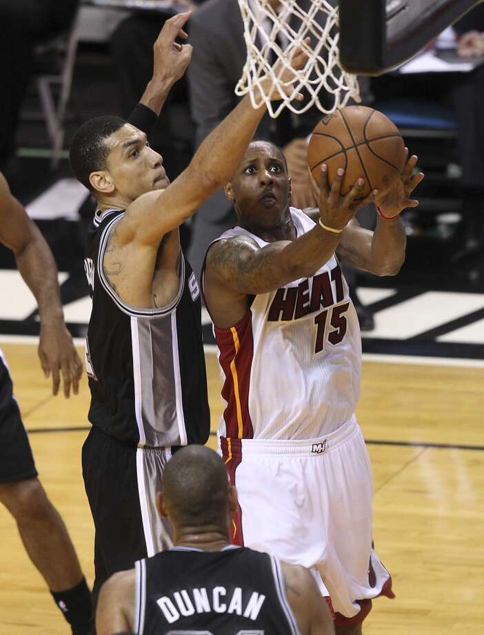 Spurs' Danny Green (04) attempts to block a layup against the Miami Heat's Mario Chalmers (15) during the second half of Game 2 of the NBA Finals at the American Airlines Arena in Miami on Sunday, June 9, 2013. (Kin Man Hui/San Antonio Express-News)
