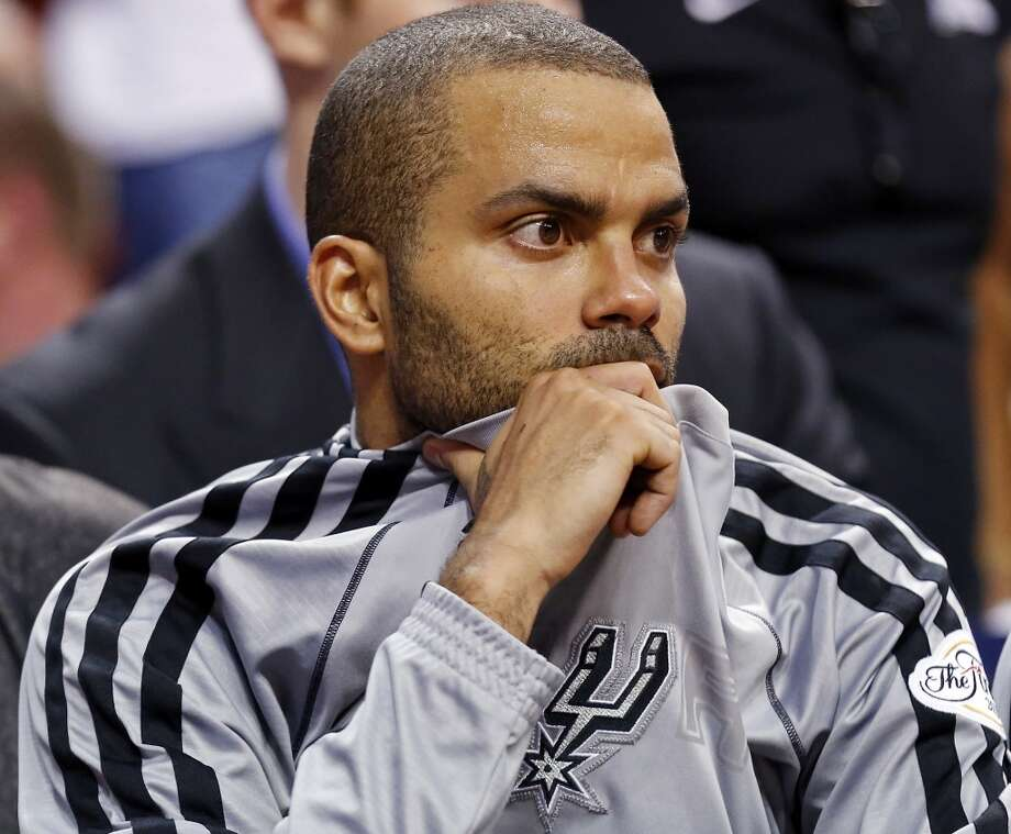 San Antonio Spurs' Tony Parker sits on the bench during second half action in Game 2 of the 2013 NBA Finals against the Miami Heat Sunday June 9, 2013 at American Airlines Arena in Miami, Fla. The Heat won 103-84.