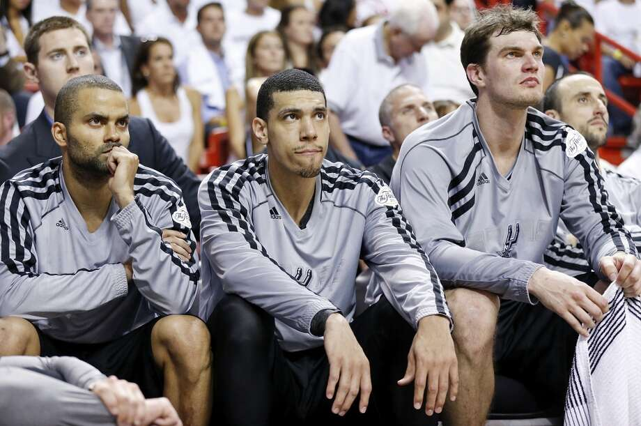 San Antonio Spurs' Tony Parker (from left), San Antonio Spurs' Danny Green, San Antonio Spurs' Tiago Splitter, and San Antonio Spurs' Manu Ginobili sit dejected on the bench during second half action in Game 2 of the 2013 NBA Finals against the Miami Heat Sunday June 9, 2013 at American Airlines Arena in Miami, Fla. The Heat won 103-84.