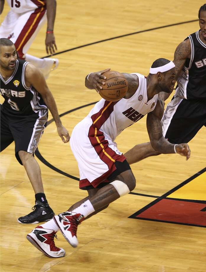 Miami's LeBron James (06) drives past Spurs' Tony Parker (09) toward Kawhi Leonard (02) during the second half of Game 2 of the NBA Finals at the American Airlines Arena in Miami on Sunday, June 9, 2013. (Kin Man Hui/San Antonio Express-News)