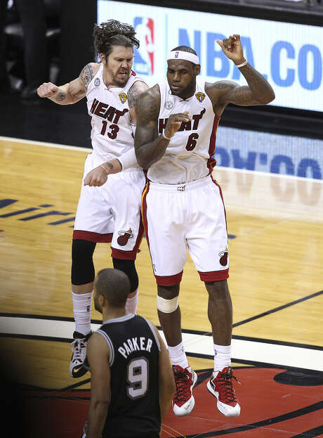 Miami's Mike Miller (left), who hit three 3-pointers and scored nine points, celebrates with LeBron James in the second half. Photo: Kin Man Hui / San Antonio Express-News