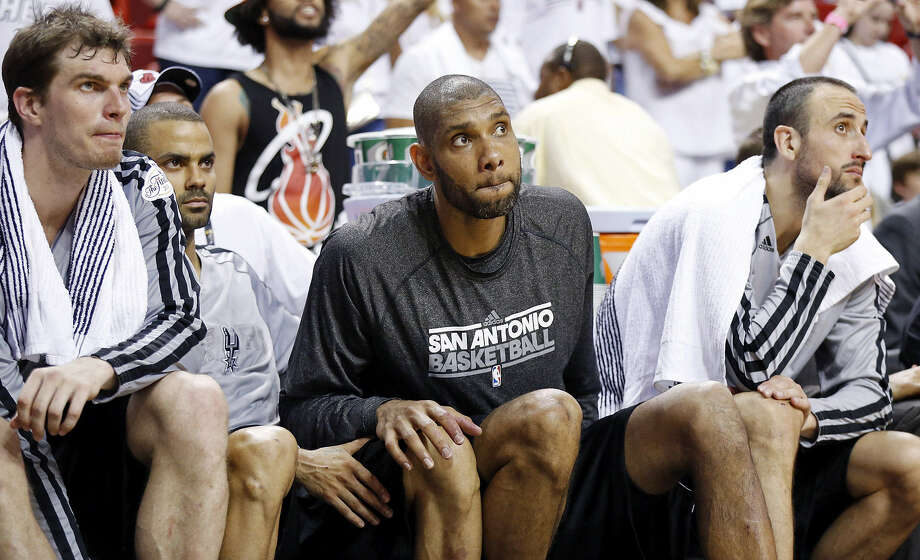 Miami's big run forced Spurs starters Tiago Splitter (from left), Tony Parker, Tim Duncan and Manu Ginobili to the bench earlier than expected Sunday night. Photo: Edward A. Ornelas / Express-News