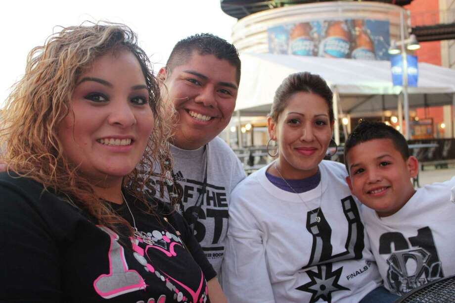 Spurs fans gather at the AT&T Center for a Game 2 viewing party as the Spurs face the Miami Heat in the NBA Finals on Sunday, June 9, 2013. Photo: Libby Castillo / For MySA.com