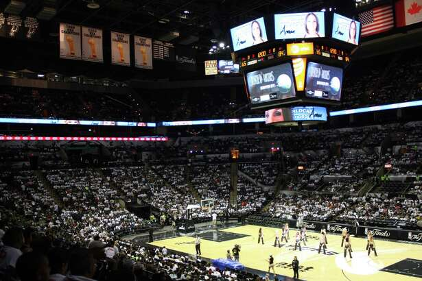 Spurs fans gather at the AT&T Center for a Game 2 viewing party as the Spurs face the Miami Heat in the NBA Finals on Sunday, June 9, 2013.