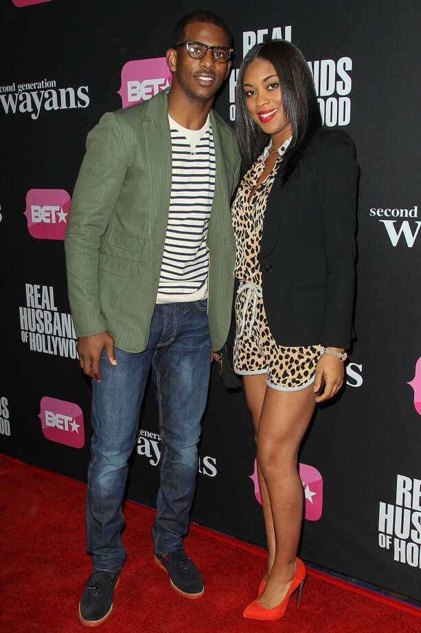 "Professional basketball player Chris Paul and wife Jada Crawley arrive at the screenings of BET Networks' ""Real Husbands of Hollywood"" and ""Second Generation Wayans"" held at the Regal Cinemas L.A. Live on January 8, 2013 in Los Angeles, California.  (Photo by Paul A. Hebert/Getty Images)"