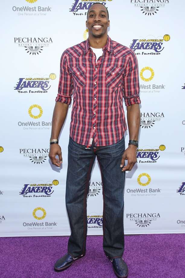 Los Angeles Laker Dwight Howard arrives at the Los Angeles Lakers Casino Night held at Club Nokia on March 10, 2013 in Los Angeles, California.  (Photo by Paul A. Hebert/Getty Images)