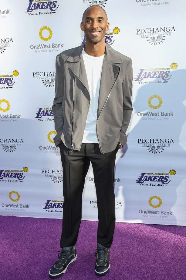 Los Angeles Laker Kobe Bryant arrives at the Los Angeles Lakers Casino Night held at Club Nokia on March 10, 2013 in Los Angeles, California.  (Photo by Paul A. Hebert/Getty Images)