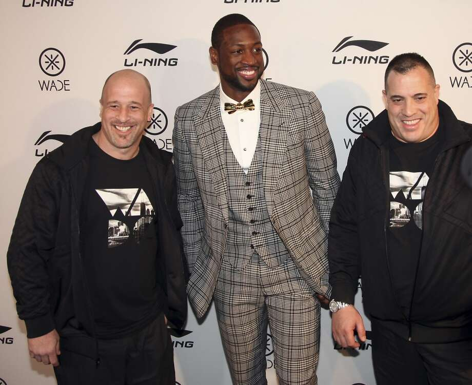 Dwyane Wade, (C)  along with Wayde King, (R) and Brett Raymer of Animal Planet's tv show Tanked at the Li-Ning/WADE Brand Party Hosted By Dwyane Wade on February 15, 2013 in Houston, Texas.  (Photo by Bob Levey/WireImage)