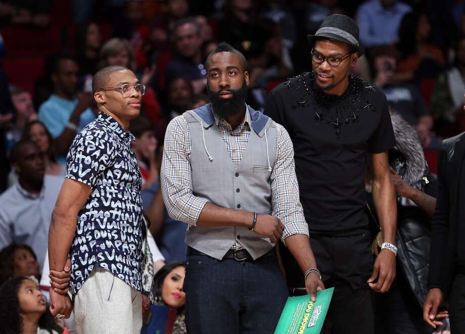 Russell Westbrook of Oklahoma City Thunder, James Harden of the Houston Rockets and Kevin Durant of the Thunder watch the Sprite Slam Dunk Contest part of 2013 NBA All-Star Weekend at the Toyota Center on February 16, 2013 in Houston, Texas. NOTE TO USER: User expressly acknowledges and agrees that, by downloading and or using this photograph, User is consenting to the terms and conditions of the Getty Images License Agreement.  (Photo by Ronald Martinez/Getty Images)