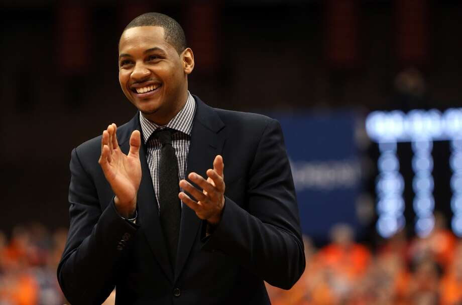 Former Syracuse Orange player Carmelo Anthony smiles and cheers as his number is retired during a ceremony at half time during the game against the Georgetown Hoyas at the Carrier Dome on February 23, 2013 in Syracuse, New York.  (Photo by Nate Shron/Getty Images)