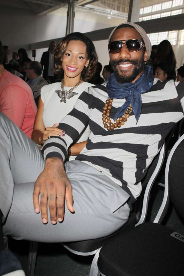 NBA Player Amar'e Stoudemire and guest seen at the Lanvin Spring / Summer 2013 show as part of Paris Fashion Week on July 1, 2012 in Paris, France. (Photo by Antonio de Moraes Barros Filho/WireImage)