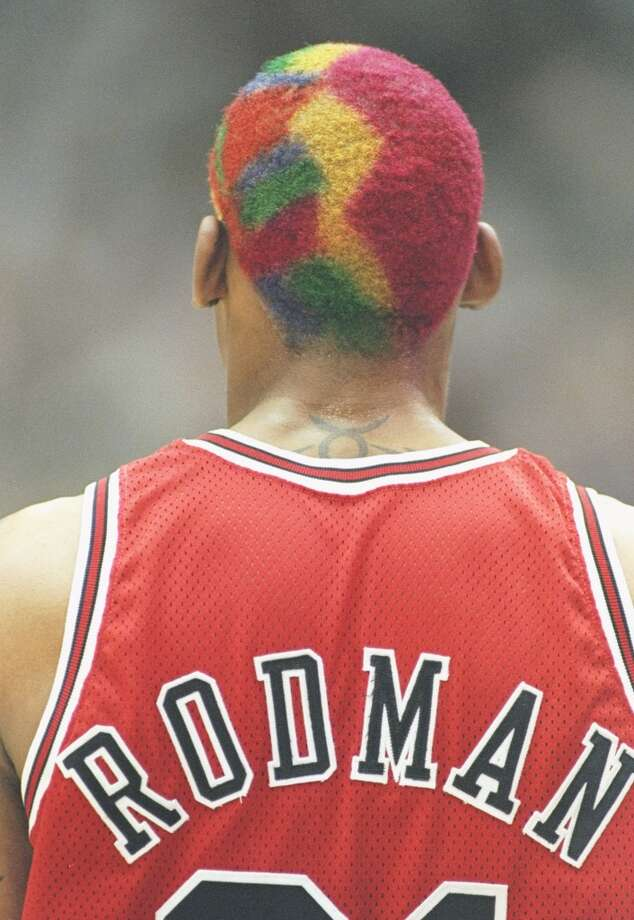 6 Jun 1997:  Forward Dennis Rodman of the Chicago Bulls stands on the court during a playoff game against the Utah Jazz at the Delta Center in Salt Lake City, Utah.  The Jazz won the game 104-93. Mandatory Credit: Jed Jacobsohn  /Allsport
