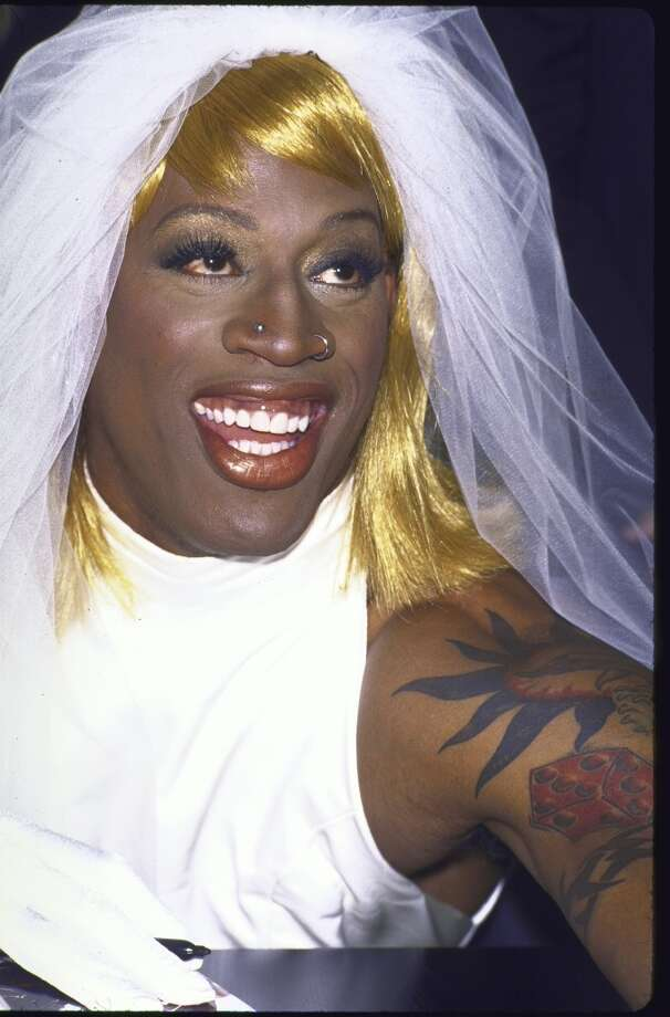 Basketball player Dennis Rodman, dressed as a bride, at his book promotion.  (Photo by Gene Shaw//Time Life Pictures/Getty Images)