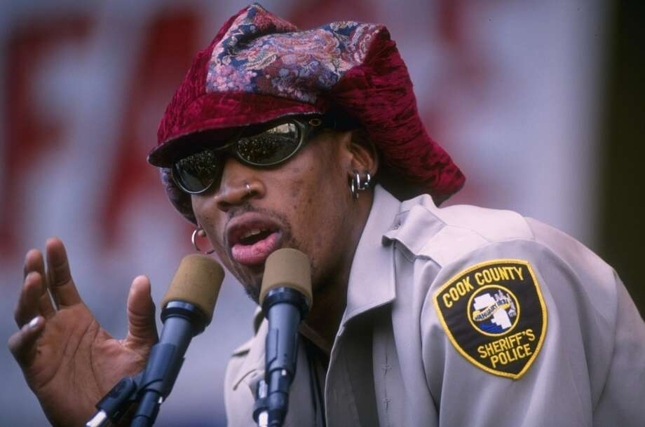 18 Jun 1996:  Forward Dennis Rodman of the Chicago Bulls talks to the crowd from the podium during the Bulls victory parade, celebrating their 1996 NBA Championship, in Chicago, Illinois. Mandatory Credit: Jonathan Daniel  /Allsport