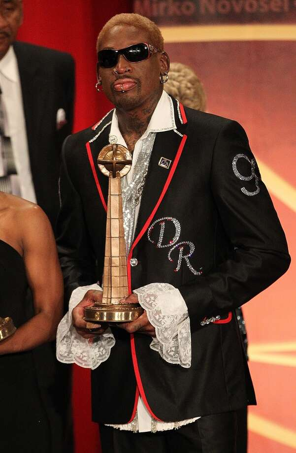 Dennis Rodman poses with his award during the Basketball Hall of Fame Enshrinement Ceremony at Symphony Hall on August 12, 2011 in Springfield, Massachusetts. (Photo by Jim Rogash/Getty Images)
