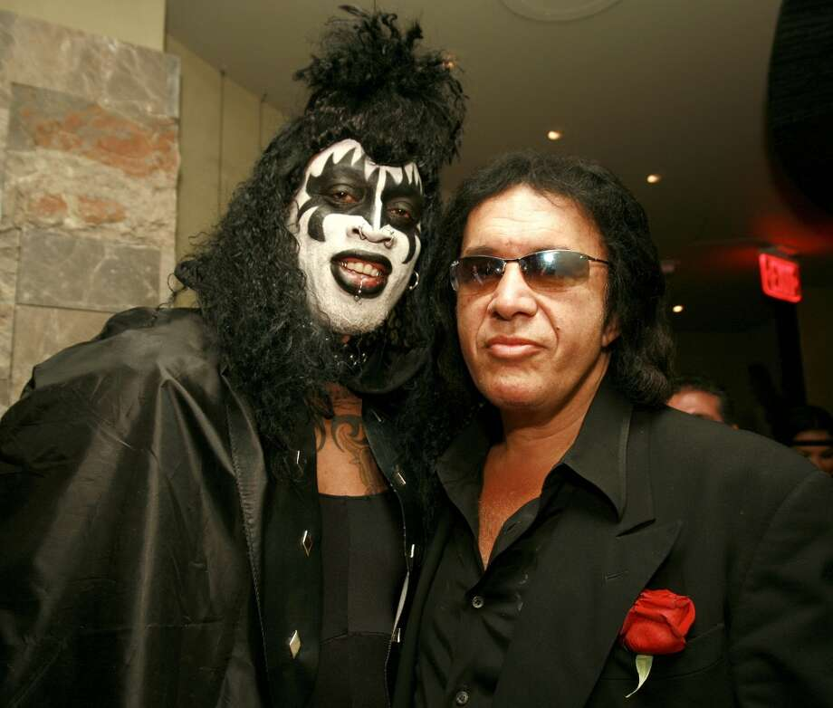 Dennis Rodman, dressed as Gene Simmons from Kiss, and the real Gene Simmons (Photo by Chris Weeks/WireImage)