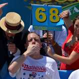 Competitive-eating champ Joey Chestnut, SJSU. 'Jaws,' center, is the seven-time defending champ of the Nathan's Famous Fourth of July International Hot Dog-Eating Contest.