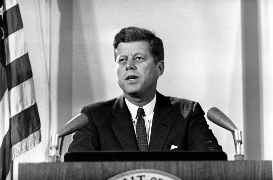 "4. John F. Kennedy: ""The most timeless and classic men's hair - people line up at barber shops these days to achieve the classic barber haircuts of the JFK era."" Photo: AP"