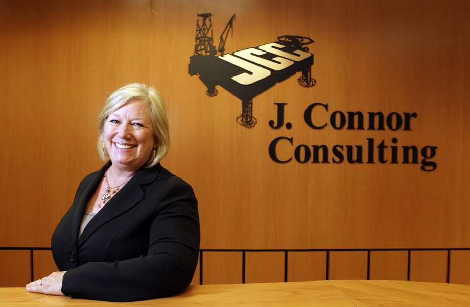 Jodie Connor of J. Connor Consultants poses in her Houston  office.  The company specializes in helping energy firms navigate government regulations.