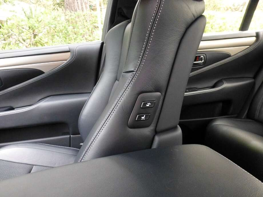 It's a convenient set of switches on the left side of the front passenger's seat back, allowing the driver to adjust the seat and its backrest.