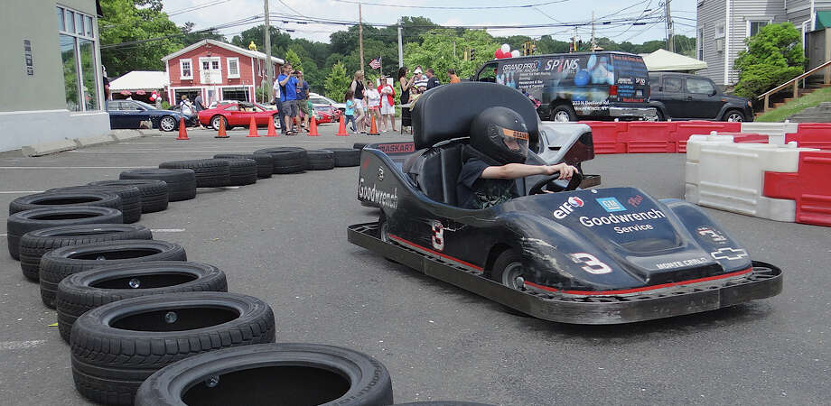 Kids race GoKarts around a small track provided by Grand Prix New York Racing at Rizzuto's Mille Ferrari event on Sunday.  WESTPORT NEWS, CT 6/9/13 Photo: Mike Lauterborn / Westport News contributed