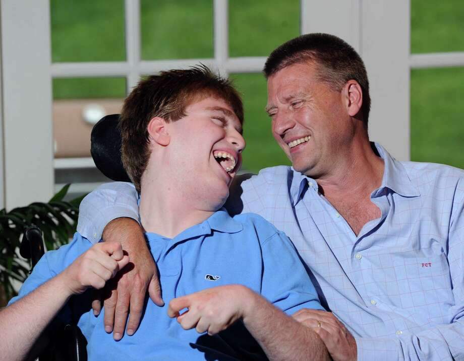 Fred Trump with his son, William, 13, share a laugh at their Greenwich home, Thursday, June 6, 2013. William Trump has cerebal palsy. Fred Trump will be hosting the June 10 Golf for Abilis benefit at the Trump National Golf Course in Briarcliff Manor, N.Y., a private club owned by his Uncle, Donald Trump. Abilis is a Greenwich orgainzation that serves the needs of the disabled. Photo: Bob Luckey / Greenwich Time