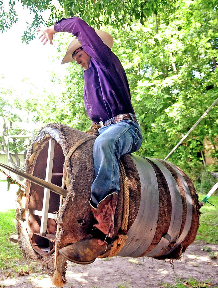 Seventeen year-old Hagen Brown, of Port Neches, warms up on his practice bull in his back yard on Friday, June 7, 2013. Photo taken: Randy Edwards/The Enterprise