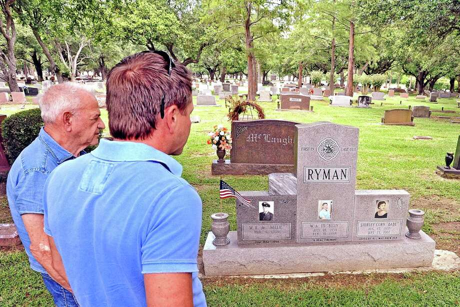From left to right, Willie Ryman Jr. and Barry Ryman look over the headstone of Willie Ryman III in the Greenlawn Memorial Park in Groves on Friday, June 7, 2013. Photo taken: Randy Edwards/The Enterprise Photo: Randy Edwards