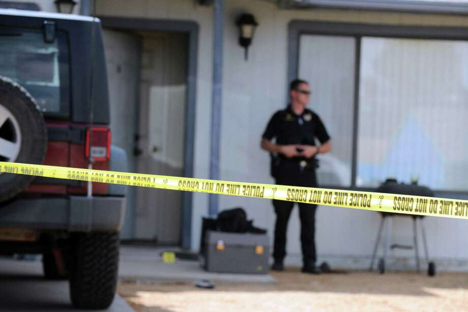 Police stand outside a home in Prescott Valley, Ariz., Friday, June 7, 2013, where an Arizona man was accidentally shot by his 4-year-old son. Justin Stanfield Thomas was fatally shot Friday after he and his son traveled from Phoenix to a friend's home 90 miles away in the northern Arizona community of Prescott Valley for a surprise visit. Prescott Valley Police Brandon Bonney says the boy found the loaded gun in the home within minutes of arrival, asked a question about it and pulled the trigger. Photo: Prescott Daily Courier, Les Stukenberg
