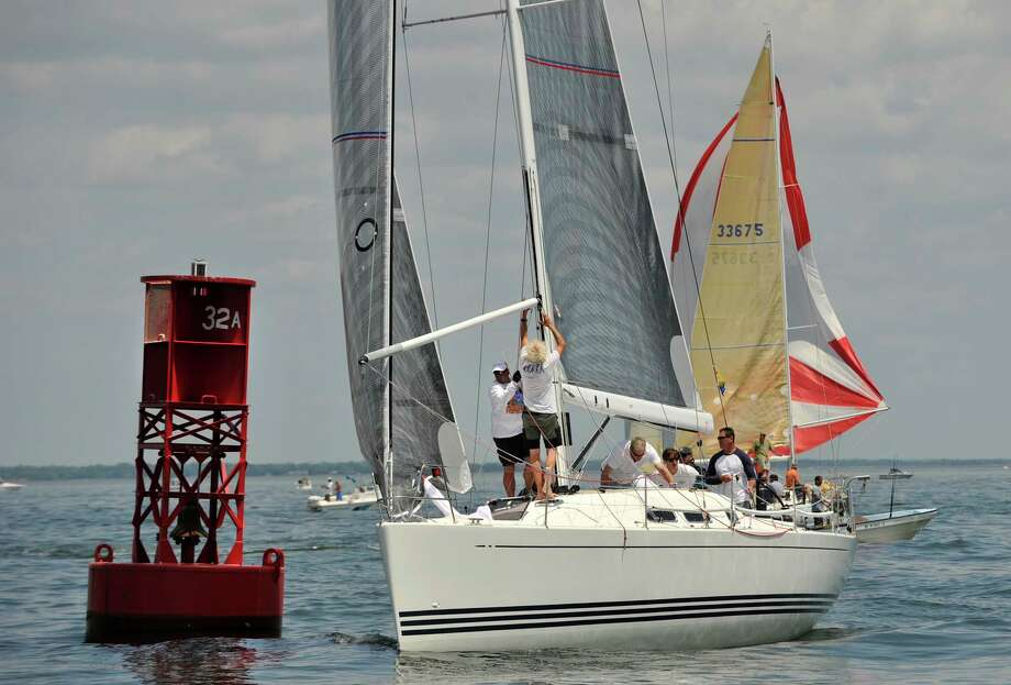 The crew from the Pendragon, hailing from Portsmouth, RI, navigates a turn around a buoy during the Mayor's Cup Race on the Long Island Sound near Stamford on Sunday, June 9, 2013. Photo: Jason Rearick / Stamford Advocate