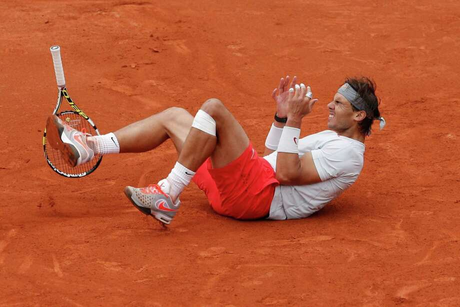 Spain's Rafael Nadal celebrates winning against compatriot David Ferrer in three sets 6-3, 6-2, 6-3, in the final of the French Open tennis tournament, at Roland Garros stadium in Paris, Sunday June 9, 2013. Photo: Christophe Ena, AP / AP
