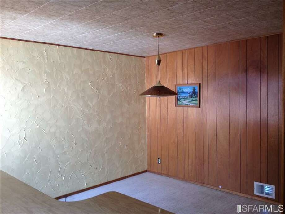 Retro (not in a good way) wall coverings in prop. #2. Photos via Redfin/MLS.