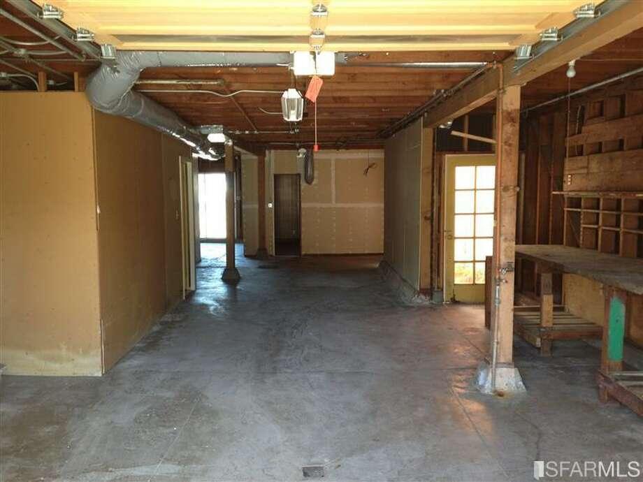 Unfinished looking garage in prop. 2. Photos via Redfin/MLS.
