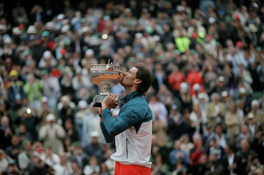 Spain's Rafael Nadal kisses the trophy after winning against compatriot David Ferrer in three sets 6-3, 6-2, 6-3, in the final of the French Open tennis tournament, at Roland Garros stadium in Paris, Sunday June 9, 2013. Photo: Petr David Josek, AP / AP