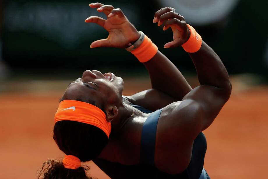 Serena Williams of the U.S. celebrates winning against Russia's Maria Sharapova in two sets 6-4, 6-4, in the women's final of the French Open tennis tournament, at Roland Garros stadium in Paris, Saturday June 8, 2013. Photo: Petr David Josek, AP / AP