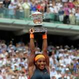 Serena Williams, of the U.S,  lifts the cup after defeating Russia's Maria Sharapova after the Women's final match of the French Open tennis tournament at the Roland Garros stadium Saturday, June 8, 2013 in Paris. Williams won 6-4, 6-4.