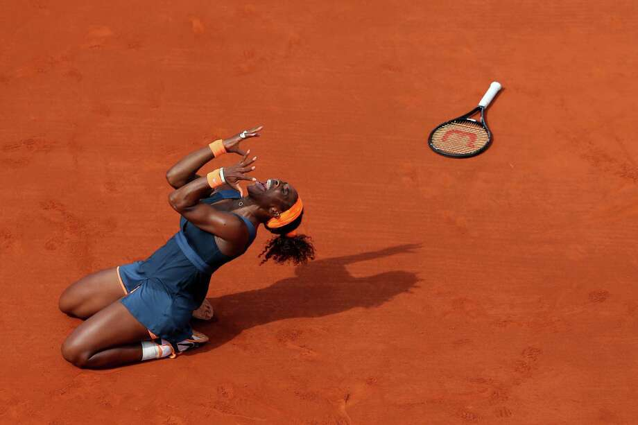 PARIS, FRANCE - JUNE 08:  Serena Williams of United States of America celebrates match point in her Women's Singles Final match against Maria Sharapova of Russia  during day fourteen of French Open at Roland Garros on June 8, 2013 in Paris, France.  (Photo by Julian Finney/Getty Images) *** BESTPIX *** Photo: Julian Finney, Getty Images / 2013 Getty Images