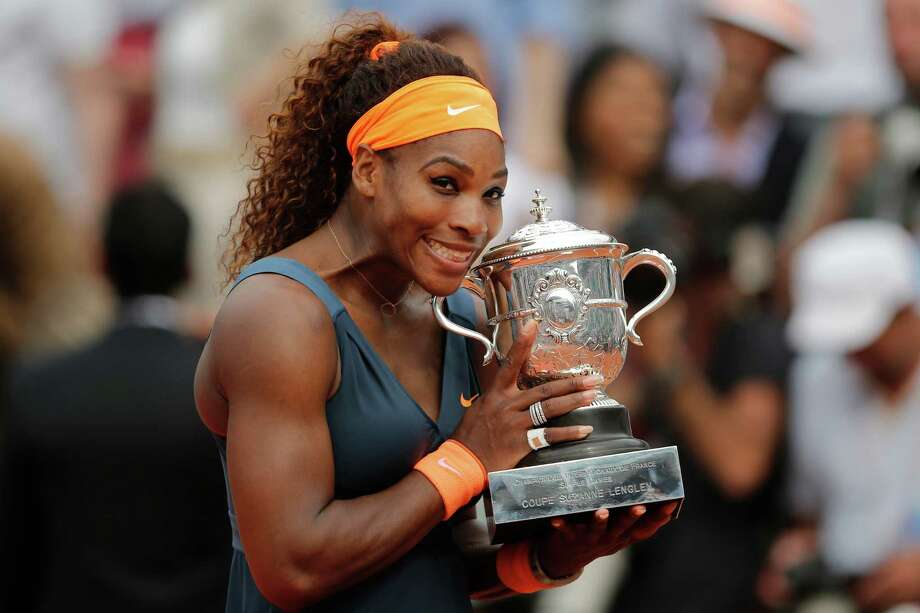 Serena Williams of the U.S. holds the trophy after defeating Russia's Maria Sharapova in two sets 6-4, 6-4, in the women's final of the French Open tennis tournament, at Roland Garros stadium in Paris, Saturday June 8, 2013. Photo: Christophe Ena, AP / AP