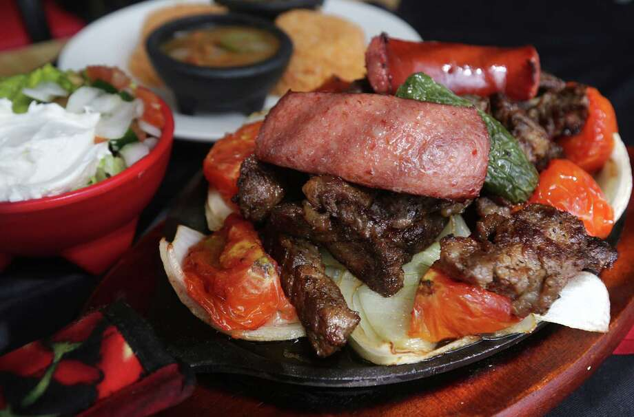 The Fajita Platter which was only served during Friday dinner at Cafe Salsita. Photo: Bob Owen, San Antonio Express-News / © 2012 San Antonio Express-News