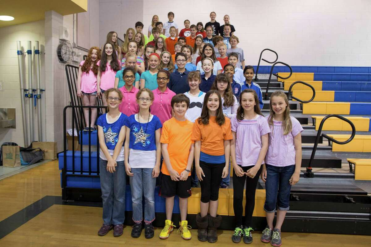 This June 6, 2013 photo shows twenty-four sets of twins who are fifth-graders at Highcrest Middle School in Wilmette, Ill. The school is attempting to break a Guinness World record for the amount of twins in one grade which is currently sixteen sets.