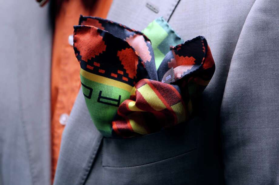 Bold-colored Southwestern print pocket square by Etro, $110 at Saks Fifth Avenue, 210-341-6666. Photo: Helen L. Montoya, SAN ANTONIO EXPRESS-NEWS / SAN ANTONIO EXPRESS-NEWS