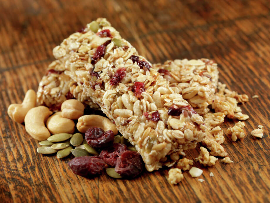 "13. Carry snacks ""This way, you'll always be prepared when hunger hits. Temptation is strong when you are hungry and faced with poor choices—so stash snack bars, or fruit or trail mix in your bag."" Shapiro's favorite snack bars are Gnu Food Bars, Kashi Granola bars and KIND fruit and nut bars. Photo: Lauri Patterson, Getty Images / (c) Lauri Patterson"