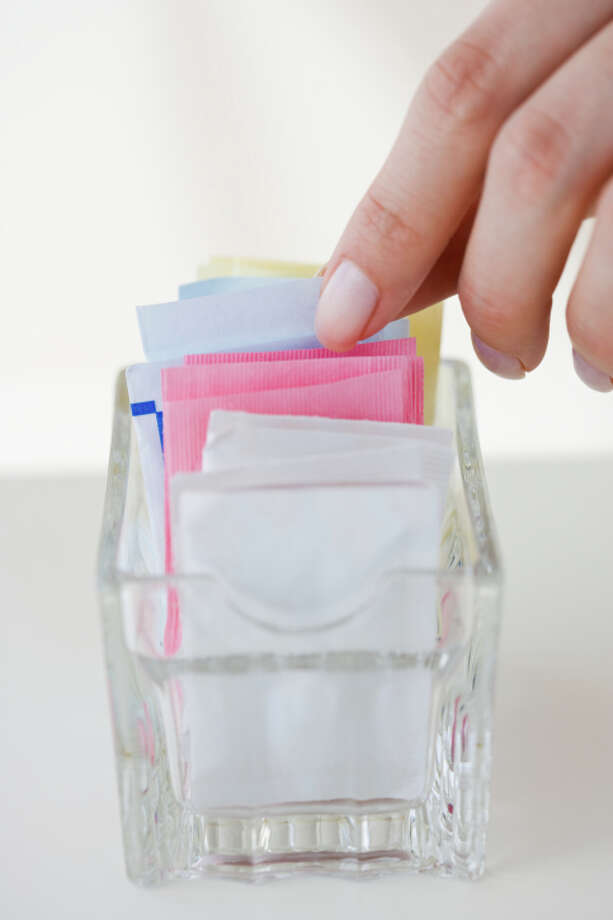 "25. Stay Away From Artificial Sweeteners ""Artificial sweeteners increase cravings and lead to bloating and fatigue. Go for one teaspoon of sugar in the raw, or honey or maple syrup. One teaspoon is only sixteen calories,"" says Middleberg. Photo: Tetra Images, Getty Images/Tetra Images RF / Tetra images RF"