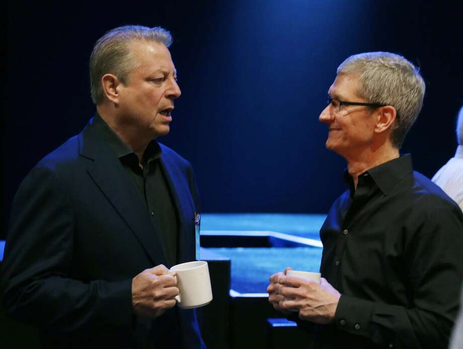 Apple CEO Tim Cook, right, talks with former Vice President Al Gore before giving the keynote address of the Apple Worldwide Developers Conference, Monday, June 10, 2013, in San Francisco.