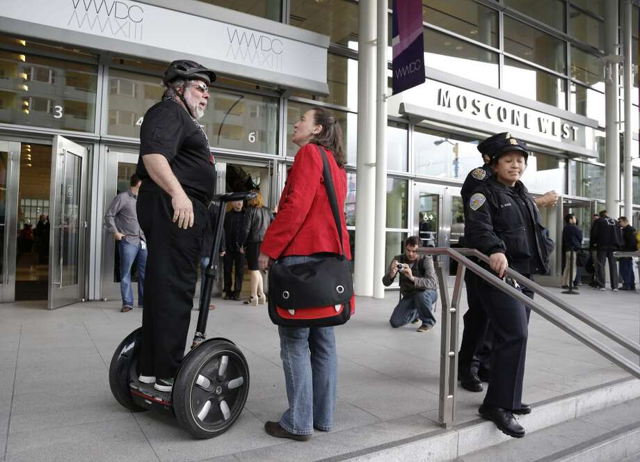 Apple co-founder Steve Wozniak is greeted on his Segway after arriving to attend the Apple Worldwide Developers Conference Monday, June 10, 2013, in San Francisco.