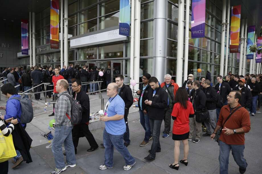 People file into the Moscone West Center for the start of the Apple Worldwide Developers Conference Monday, June 10, 2013 in San Francisco.