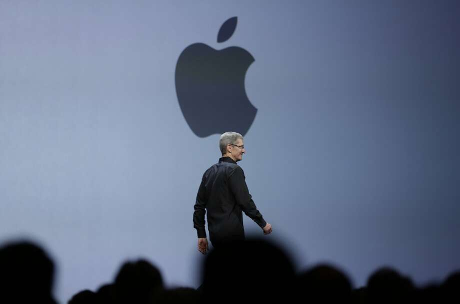 Apple CEO Tim Cook walks on stage to deliver the keynote address of the Apple Worldwide Developers Conference, Monday, June 10, 2013, in San Francisco.