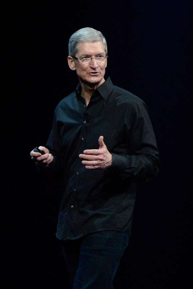 Tim Cook, chief executive officer of Apple Inc., speaks during the keynote of the World Wide Developers Conference (WWDC) in San Francisco, California U.S. on Monday, June 10, 2013. Apple Inc. is preparing to unveil sweeping changes to the software powering iPhones and iPads, seeking to reignite desire for its products and blunt the advance of Google Inc.'s Android mobile operating system.